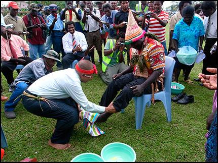 Chan washing Tanis' feet