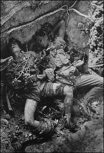 Two soldiers in pit (c) Don McCullin
