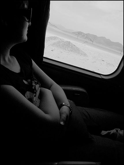 Edwina looking out window enroute to Lima